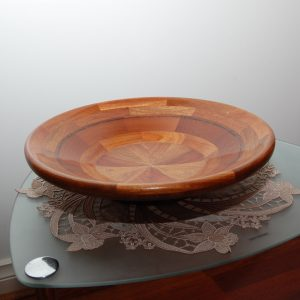 Laminated timber bowl with segments. Made with New Guinea Rosewood. Approx cost $150.