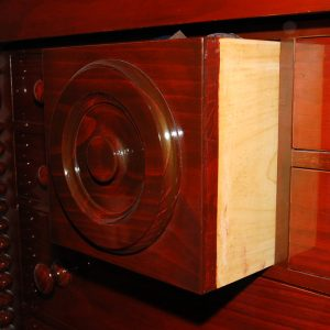 Gentleman's chest of draws with a secret compartment. Made with Australian timbers and stained in English mahogany.