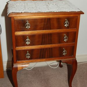 Three draw cabriole legged (characteristic of a Chippendale style) bedside table. Made from Australian timbers.
