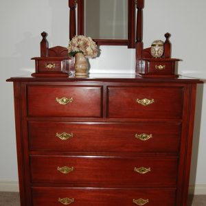 Copy of a Dutchess Chest of Draws with jewel boxes and mirror. Made out of Australian timber, stained with clear lacquer.