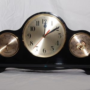 Mantle clock with barometer made with New Zealand clear pine. Mahogany stain. Approx cost $270.